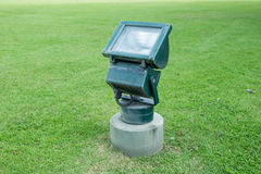Old lamp on green grass Royalty Free Stock Photo