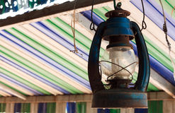 The old lamp hangs on beam colorful  background. Royalty Free Stock Image
