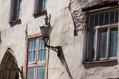 Old lamp on the house in Tallinn Stock Image