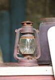 Old lamp, Hurricane lamp. /storm lantern; very corroded vintage kerosene lamp stock photo