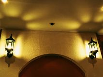 Old lamp Indoor lights on the wall at night.  royalty free stock images