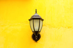 Old lamp lantern on the stone wall Royalty Free Stock Photo