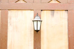 Old lamp lantern on the stone wall Stock Photos