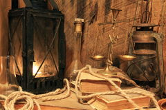 Old lamp with lighted candle. On wooden background Royalty Free Stock Photo