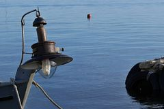 Old lamp for night deep-sea fishing installed on fisherman boat. Royalty Free Stock Photos