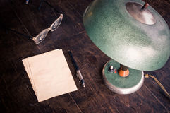 Old lamp and paper Royalty Free Stock Image