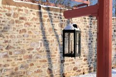 The old lamp post. The antique lamp post by the stone wall Royalty Free Stock Photography