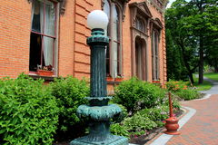 Old lamp post and brick walkway outside historic Canfield Casino,Saratoga,New York,2015 Royalty Free Stock Image