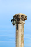 Old lamp post beside the sea Royalty Free Stock Photo