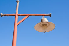 Old lamp on the red pillar. Lamp is located on the red pillar Stock Photography