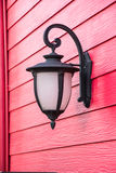 Old lamp on red wood wall Stock Photos
