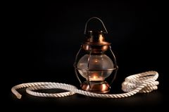 Old lamp and rope Royalty Free Stock Images