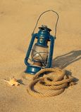 Old lamp on the sandy beach Stock Image