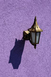 Old lamp with shadow. On the wall Royalty Free Stock Photo