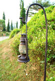 Old lamp on sidewalk Royalty Free Stock Photo