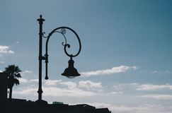 Old lamp silhouette over blue sky - body copy - city of cagliari stock photography