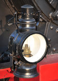 Old lamp on a steam locomotive. Old iron lamp on a steam locomotive Royalty Free Stock Image