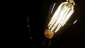 An old lamp turns on and off. An old lamp turns on and off with vintage bulb stock video footage