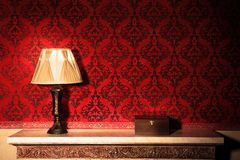 Old lamp in vintage interior next to wooden box Stock Image
