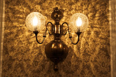 Old lamp and wallpaper Stock Photography