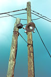 Old lamp on wooden post with security cameras Royalty Free Stock Photos