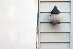 Old lamp on a wooden wall Royalty Free Stock Photo