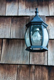Old Lamp on a Wooden Wall. Old lamp on a wooden house wall in San Francisco royalty free stock images