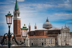 Old Lampost with Venice in Background Royalty Free Stock Image