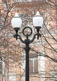 Old lamppost. In the spring park Stock Photos