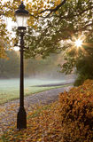 Old lamppost. Lamppost at walkway in autumn royalty free stock photography