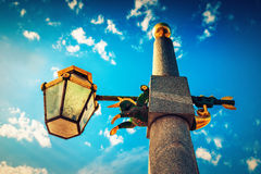 Old lamppost. With small horse statue over blue sky in Saint Petersburg, Russia Royalty Free Stock Photo