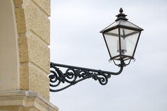 Old lamppost on a wall Stock Images