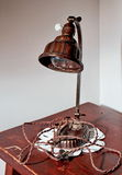 Old lamps. Old lamp with a light bulb on a wooden table Royalty Free Stock Image