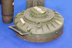 Old land mine. Land mine on blue carpet not activated Stock Photo