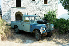 Old landrover defender abandoned greece Stock Images