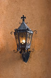 Old lantern. Old black lantern on adobe wall Royalty Free Stock Images