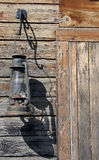 Old Lantern. Antique Lantern Beside Cabin Door royalty free stock images