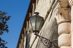 Old lantern. Above the entrance to the old fortress walls hanging lantern Stock Photos