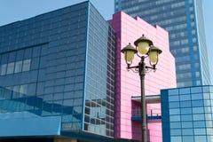 Old lantern against modern building Stock Images