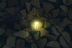 Old lantern in the barn with firewood stock photos