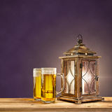 Old lantern with beer on purple vintage background Royalty Free Stock Photo