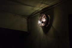 Old lantern in the bombshelter. Dim lighting in an old bombshelter Royalty Free Stock Photos