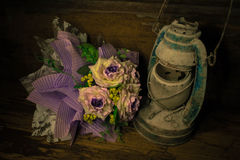 Old lantern and Bouquet of purple flowers Stock Images