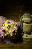 Old lantern and Bouquet of purple flowers Stock Photos
