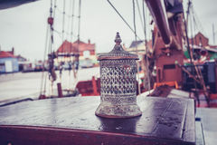 Old lantern on the deck of a ship Stock Photos