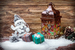 Old lantern and gifts in the snow royalty free stock photography