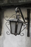 Old lantern on a gray wall Stock Images