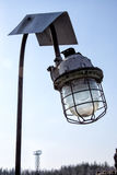 Old lantern in an industrial plant Stock Photo