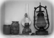 Old lantern and kerosene lamp on the shelf. Vintage still life with old lantern and kerosene lamp on the shelf Royalty Free Stock Photos