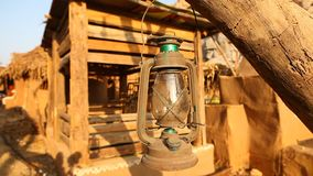 Old lantern lamp at tree stock video footage